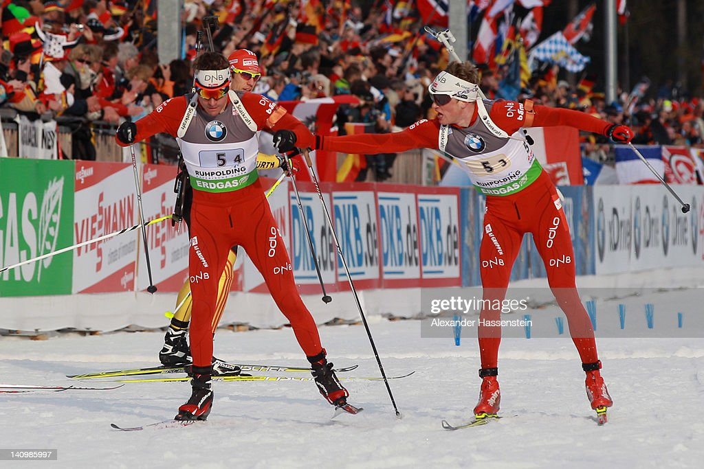 Tarjei Boe (R) of team Norway hands over to his team mate Emil Hegle Svendsen during the Men's 4 x 7.5km Relay during the IBU Biathlon World Championships at Chiemgau Arena on March 9, 2012 in Ruhpolding, Germany.