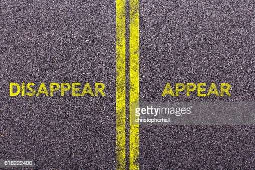 Tarmac with the words disappear and appear : Stock Photo
