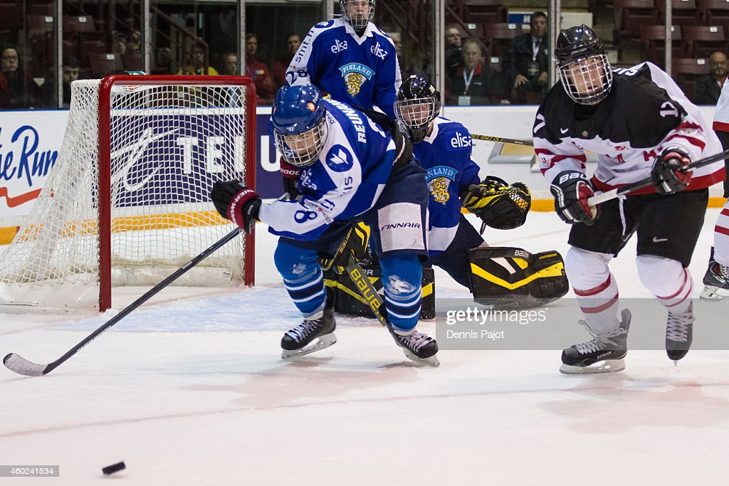 Tarmo Reunanen #8 of Finland skates against Anthony Salinitri #17 of Canada White during the World Under-17 Hockey Challenge on November 2, 2014 at the RBC Centre in Sarnia, Ontario.