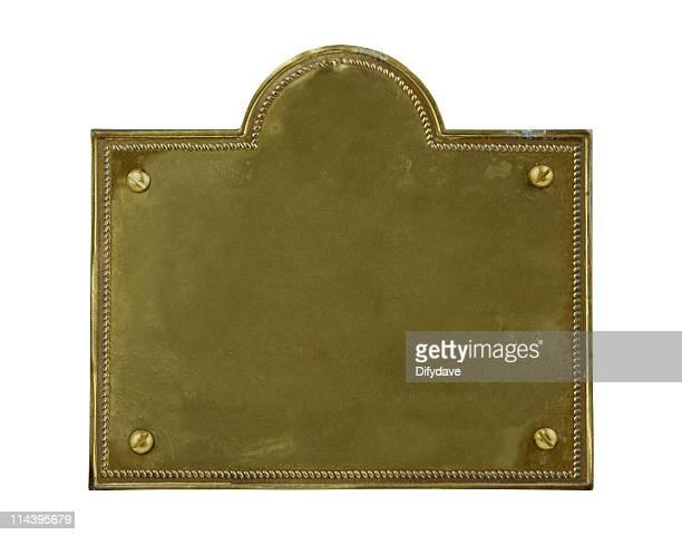 Ancienne plaque en laiton terni