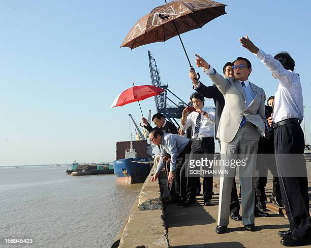 Taro Aso Japanese finance minister and deputy prime minister gestures during his visit to a project at the huge Thilawa industrial zone near Yangon...