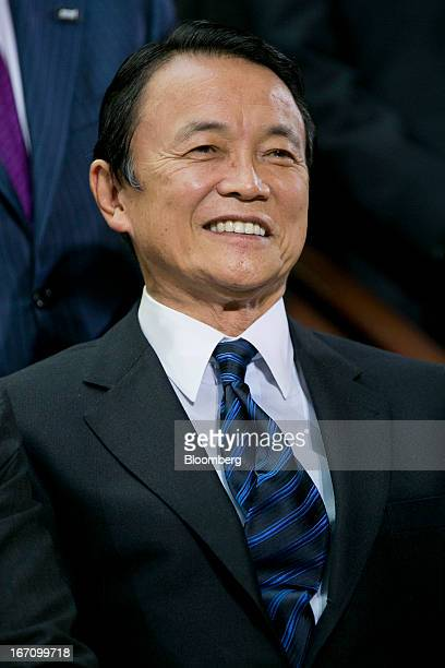 Taro Aso Japan's deputy prime minister and finance minister attends an International Monetary Fund governors group photograph during the IMF and...