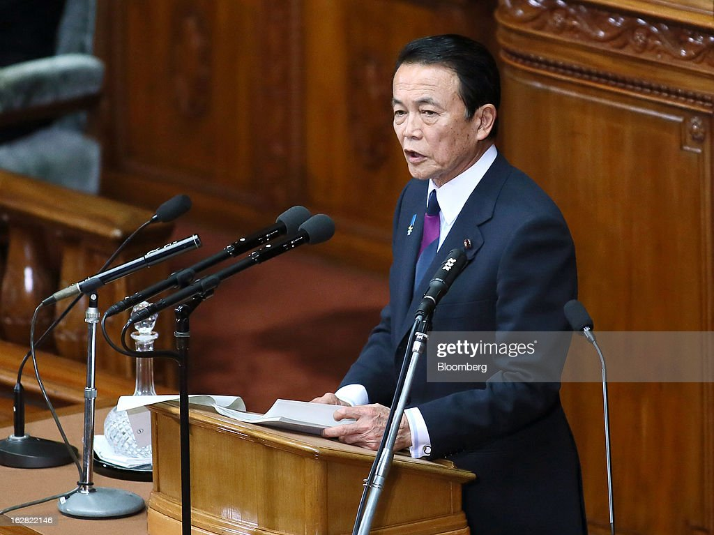 <a gi-track='captionPersonalityLinkClicked' href=/galleries/search?phrase=Taro+Aso&family=editorial&specificpeople=559212 ng-click='$event.stopPropagation()'>Taro Aso</a>, Japan's deputy prime minister and finance minister, delivers his policy speech at the lower house of Parliament in Tokyo, Japan, on Thursday, Feb. 28, 2013. Aso said Japan's fiscal state is very grim, and the government can't provide fiscal stimulus perpetually. Photographer: Haruyoshi Yamaguchi/Bloomberg via Getty Images