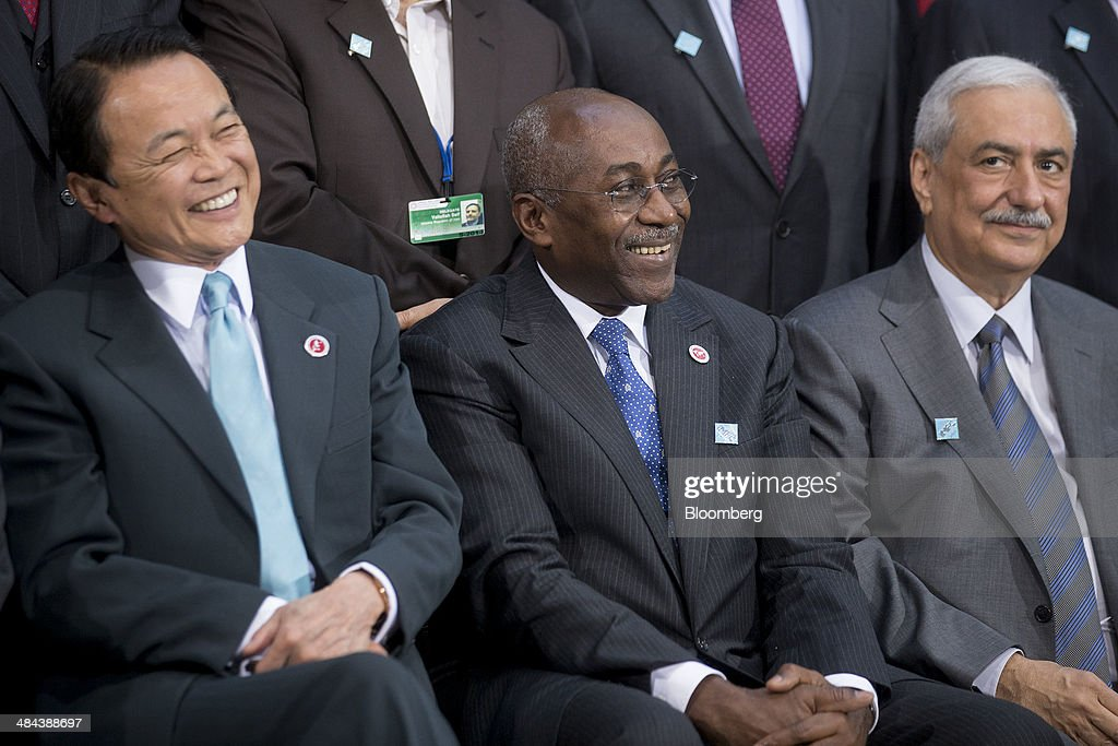 <a gi-track='captionPersonalityLinkClicked' href=/galleries/search?phrase=Taro+Aso&family=editorial&specificpeople=559212 ng-click='$event.stopPropagation()'>Taro Aso</a>, Japan's deputy prime minister and finance minister, from left, Christophe Akagha-Mba, Gabon's economy minister, and Ibrahim al-Assaf, Saudi Arabia's finance minister, attend the International Monetary Fund (IMF) governors family photograph at the IMF and World Bank Group Spring Meetings in Washington, D.C., U.S., on Saturday, April 12, 2014. International central bankers pledged to take care in telegraphing monetary-policy shifts and consider their global effects amid renewed calls from emerging markets for greater cooperation. Photographer: Andrew Harrer/Bloomberg via Getty Images