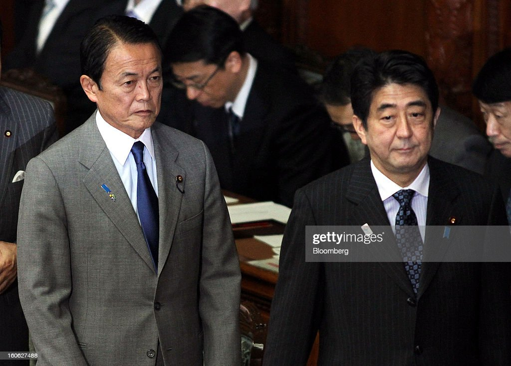 <a gi-track='captionPersonalityLinkClicked' href=/galleries/search?phrase=Taro+Aso&family=editorial&specificpeople=559212 ng-click='$event.stopPropagation()'>Taro Aso</a>, Japan's deputy prime minister and finance minister, left, and <a gi-track='captionPersonalityLinkClicked' href=/galleries/search?phrase=Shinzo+Abe&family=editorial&specificpeople=559017 ng-click='$event.stopPropagation()'>Shinzo Abe</a>, Japan's prime minister, attend a plenary session at the lower house of Parliament in Tokyo, Japan, on Monday, Feb. 4, 2013. Aso said Japan will keep monitoring the currency markets carefully. Photographer: Haruyoshi Yamaguchi/Bloomberg via Getty Images