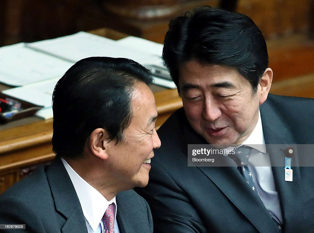 <a gi-track='captionPersonalityLinkClicked' href=/galleries/search?phrase=Taro+Aso&family=editorial&specificpeople=559212 ng-click='$event.stopPropagation()'>Taro Aso</a>, Japan's deputy prime minister and finance minister, left, speaks to <a gi-track='captionPersonalityLinkClicked' href=/galleries/search?phrase=Shinzo+Abe&family=editorial&specificpeople=559017 ng-click='$event.stopPropagation()'>Shinzo Abe</a>, Japan's prime minister, during a plenary session at the upper house of the parliament in Tokyo, Japan, on Tuesday, Feb. 26, 2013. Abe's policies aimed at ending deflation could distort trade, drive up asset prices in other nations and lead to global financial instability, according to HSBC Holdings Plc. Photographer: Haruyoshi Yamaguchi/Bloomberg via Getty Images