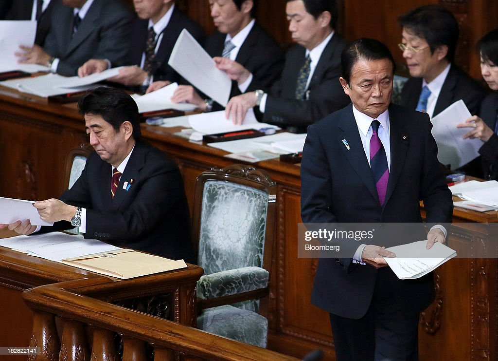 <a gi-track='captionPersonalityLinkClicked' href=/galleries/search?phrase=Taro+Aso&family=editorial&specificpeople=559212 ng-click='$event.stopPropagation()'>Taro Aso</a>, Japan's deputy prime minister and finance minister, right, prepares to deliver his policy speech as <a gi-track='captionPersonalityLinkClicked' href=/galleries/search?phrase=Shinzo+Abe&family=editorial&specificpeople=559017 ng-click='$event.stopPropagation()'>Shinzo Abe</a>, Japan's prime minister, left, looks on at the lower house of Parliament in Tokyo, Japan, on Thursday, Feb. 28, 2013. Aso said Japan's fiscal state is very grim, and the government can't provide fiscal stimulus perpetually. Photographer: Haruyoshi Yamaguchi/Bloomberg via Getty Images