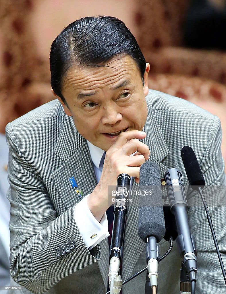 <a gi-track='captionPersonalityLinkClicked' href=/galleries/search?phrase=Taro+Aso&family=editorial&specificpeople=559212 ng-click='$event.stopPropagation()'>Taro Aso</a>, Japan's deputy prime minister and finance minister, speaks during a budget committee session at the upper house of parliament in Tokyo, Japan, on Wednesday, Feb. 20, 2013. Prime Minister Shinzo Abe said that the need to buy foreign bonds has decreased, backing away from a policy proposal that may be seen by other nations as a direct attempt to weaken the yen. Photographer: Haruyoshi Yamaguchi/Bloomberg via Getty Images