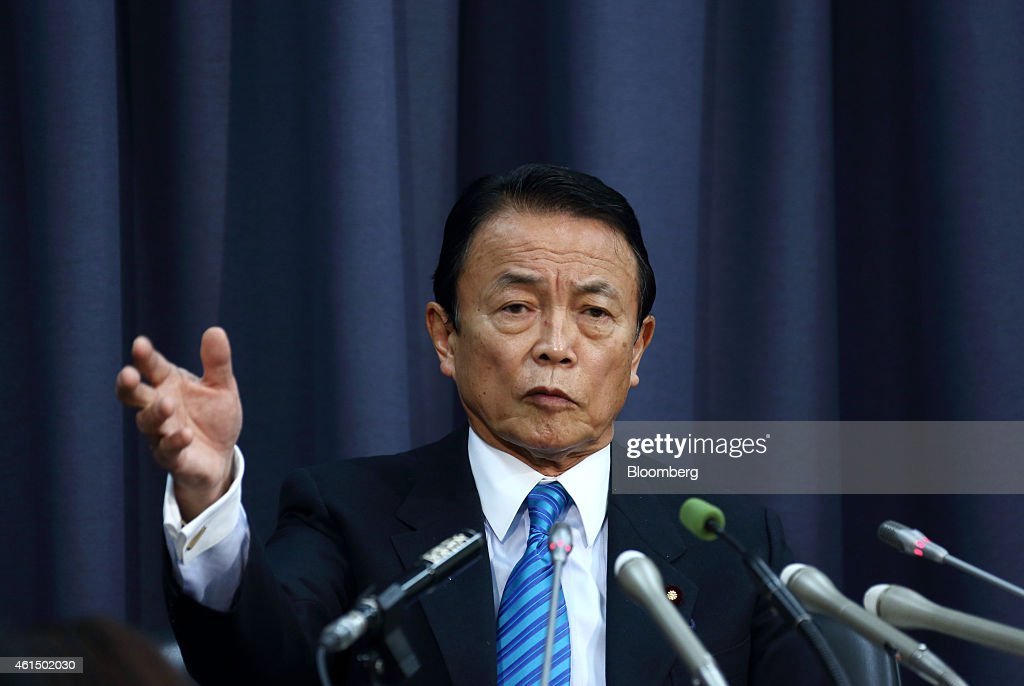 <a gi-track='captionPersonalityLinkClicked' href=/galleries/search?phrase=Taro+Aso&family=editorial&specificpeople=559212 ng-click='$event.stopPropagation()'>Taro Aso</a>, Japan's deputy prime minister and finance minister, speaks during a news conference in Tokyo, Japan, on Wednesday, Jan. 14, 2015. Japan plans a record budget for next fiscal year to support an economy that fell into recession after Prime Minister Shinzo Abe's government increased the sales tax. Photographer: Tomohiro Ohsumi/Bloomberg via Getty Images
