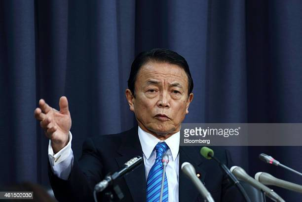 Taro Aso Japan's deputy prime minister and finance minister speaks during a news conference in Tokyo Japan on Wednesday Jan 14 2015 Japan plans a...