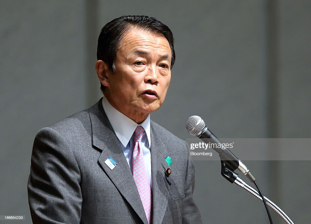 Taro Aso, Japan's deputy prime minister and finance minister, speaks at the annual meeting of the Trust Companies Association of Japan in Tokyo, Japan, on Monday, April 15, 2013. Kuroda reiterated today that he has a two-year time horizon in mind for achieving his inflation goal. He will also speak today at the annual meeting. Photographer: Tomohiro Ohsumi/Bloomberg via Getty Images