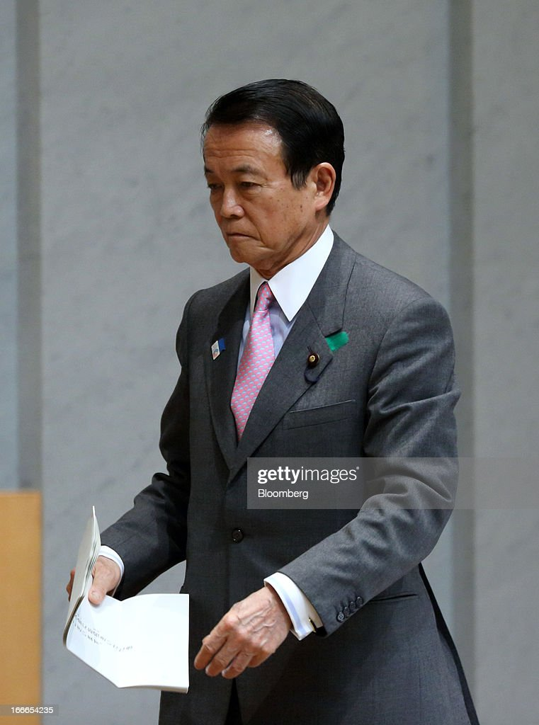 <a gi-track='captionPersonalityLinkClicked' href=/galleries/search?phrase=Taro+Aso&family=editorial&specificpeople=559212 ng-click='$event.stopPropagation()'>Taro Aso</a>, Japan's deputy prime minister and finance minister, walks to the podium at the annual meeting of the Trust Companies Association of Japan in Tokyo, Japan, on Monday, April 15, 2013. Kuroda reiterated today that he has a two-year time horizon in mind for achieving his inflation goal. He will also speak today at the annual meeting. Photographer: Tomohiro Ohsumi/Bloomberg via Getty Images