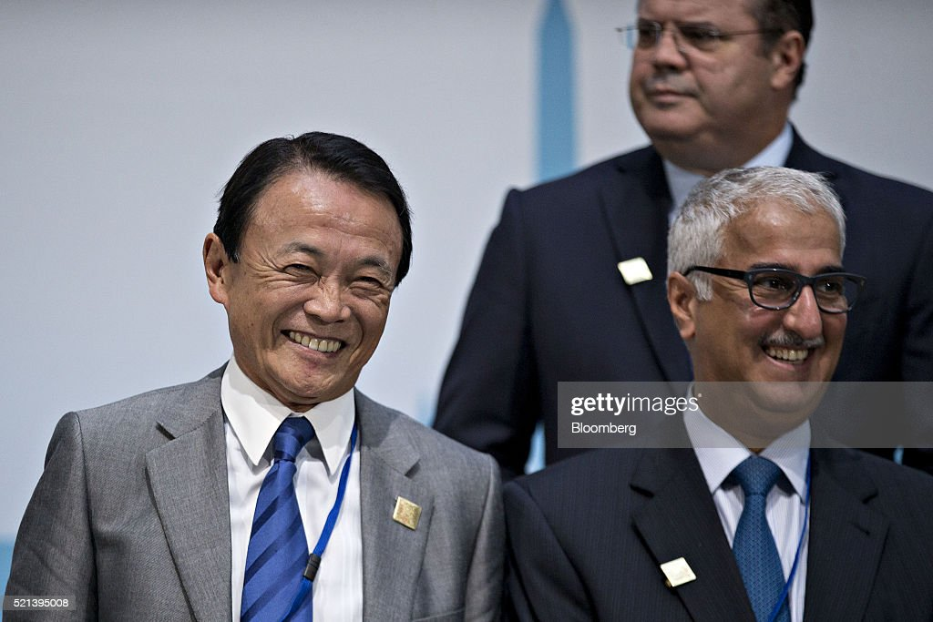 <a gi-track='captionPersonalityLinkClicked' href=/galleries/search?phrase=Taro+Aso&family=editorial&specificpeople=559212 ng-click='$event.stopPropagation()'>Taro Aso</a>, Japan's deputy prime minister and minister for finance and financial services, left, and Ibrahim Al-Assaf, Saudi Arabia's finance minister, laugh during a Group of 20 (G-20) finance ministers and central bank governors group photo on the sidelines of the spring meetings of the International Monetary Fund (IMF) and World Bank in Washington, D.C., U.S., on Friday, April 15, 2016. Group of 20 economies threatened to penalize tax havens that dont share information on their banking clients, after the leak of the Panama Papers provoked a global uproar over tax evasion. Photographer: Andrew Harrer/Bloomberg via Getty Images
