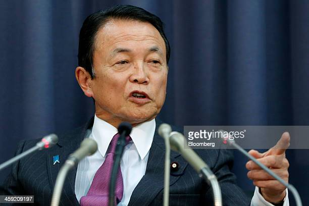Taro Aso Japan's finance minister gestures as he speaks during a news conference at the Ministry of Finance in Tokyo Japan on Tuesday Dec 24 2013...