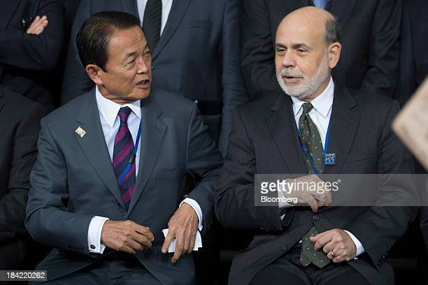 Taro Aso Japan's finance minister left and Ben S Bernanke chairman of the US Federal Reserve attend the International Monetary Fund governors group...