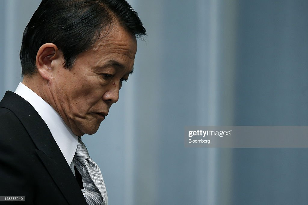 Taro Aso, Japan's newly appointed deputy prime minister and minister for finance and financial services, leaves a news conference at the prime minister's official residence in Tokyo, Japan, on Thursday, Dec. 27, 2012. Japan's parliament confirmed Shinzo Abe as the nation's seventh prime minister in six years, returning him to the office he left in 2007 after his party regained power in a landslide election victory last week. Photographer: Kiyoshi Ota/Bloomberg via Getty Images