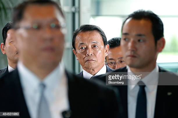 Taro Aso Japan's reappointed deputy prime minister and minister for finance and financial services center arrives at the prime minister's official...