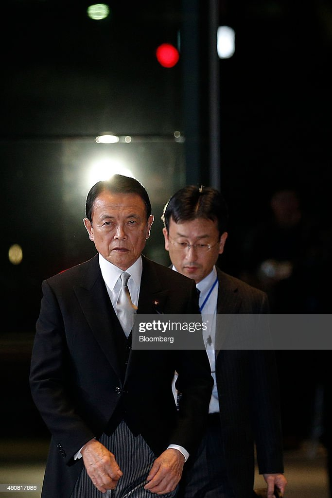 <a gi-track='captionPersonalityLinkClicked' href=/galleries/search?phrase=Taro+Aso&family=editorial&specificpeople=559212 ng-click='$event.stopPropagation()'>Taro Aso</a>, Japan's re-appointed deputy prime minister and minister for finance and financial services, left, arrives at the prime minister's official residence before heading to the Imperial Palace for the attestation ceremony in Tokyo, Japan, on Wednesday, Dec. 24, 2014. Japanese Prime Minister Shinzo Abe appointed a former soldier and security veteran as his new defense minister, as he prepares to push through legislation to toughen the country's military stance amid a dispute with China. Photographer: Kiyoshi Ota/Bloomberg via Getty Images