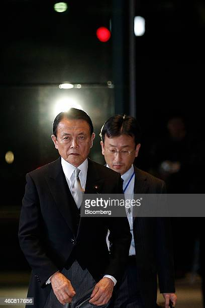 Taro Aso Japan's reappointed deputy prime minister and minister for finance and financial services left arrives at the prime minister's official...