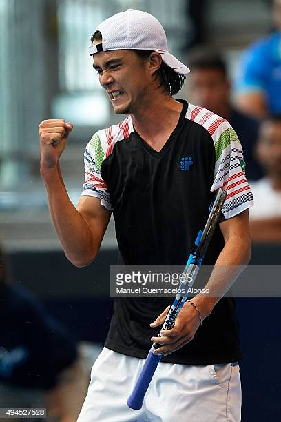 Taro Daniel of Japan celebrates a point against Michal Przysiezny of Poland during day two of the ATP World Tour Valencia Open tennis tournament at...