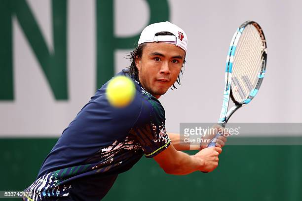 Taro Daniel of Japan hits a backhand during the Men's Singles first round match against Martin Klizan of Slovakia on day two of the 2016 French Open...