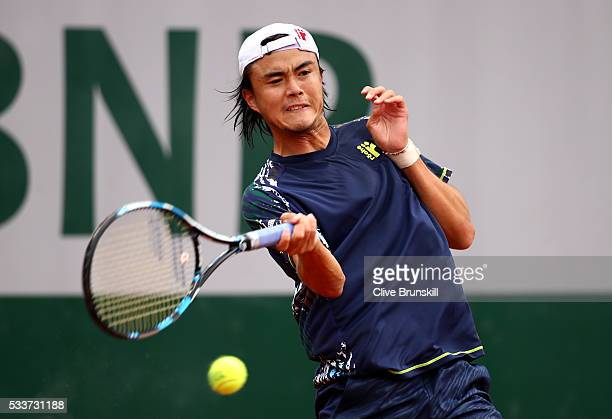 Taro Daniel of Japan hits a forehand during the Men's Singles first round match against Martin Klizan of Slovakia on day two of the 2016 French Open...