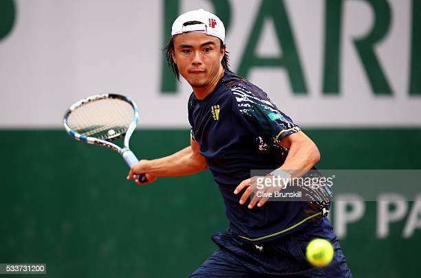 Taro Daniel of Japan lines up a forehand during the Men's Singles first round match against Martin Klizan of Slovakia on day two of the 2016 French...
