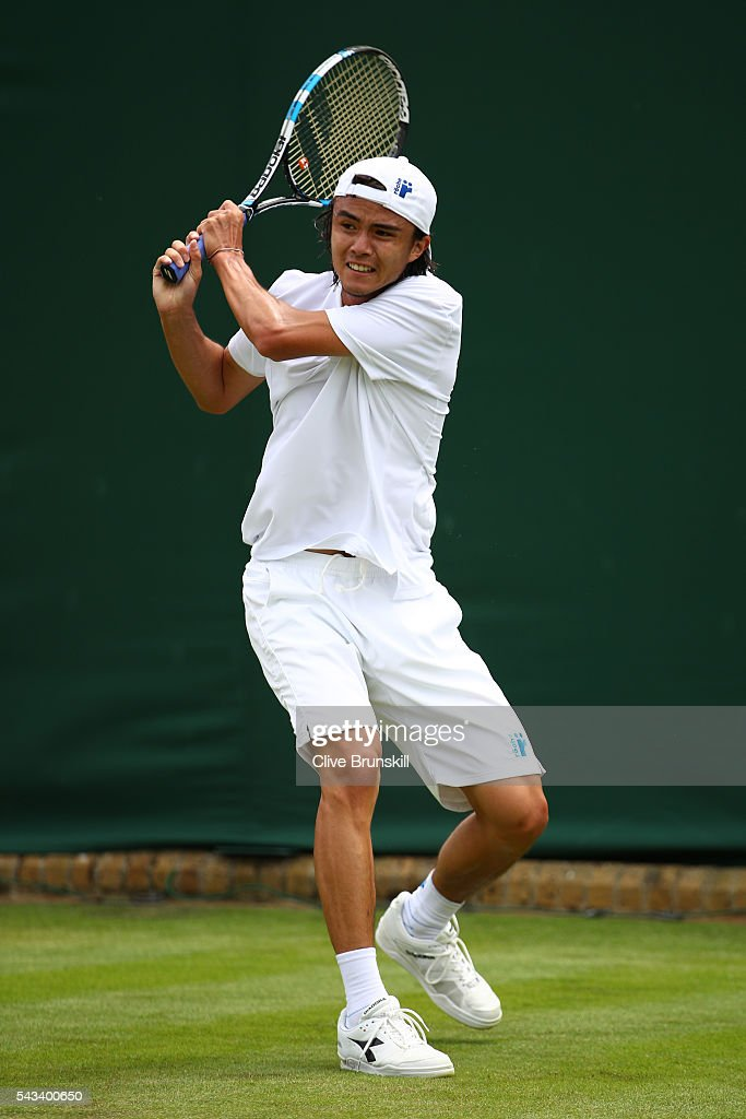 <a gi-track='captionPersonalityLinkClicked' href=/galleries/search?phrase=Taro+Daniel&family=editorial&specificpeople=7180028 ng-click='$event.stopPropagation()'>Taro Daniel</a> of Japan plays a backhand during the Men's Singles first round match against Juan Monaco of Argentina on day two of the Wimbledon Lawn Tennis Championships at the All England Lawn Tennis and Croquet Club on June 28, 2016 in London, England.