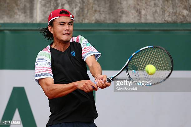 Taro Daniel of Japan plays a backhand in his Men's Singles match against Fernando Verdasco of Spain on day two of the 2015 French Open at Roland...