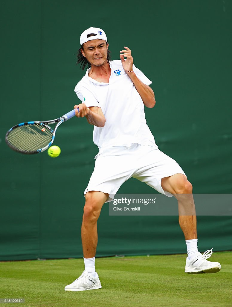 <a gi-track='captionPersonalityLinkClicked' href=/galleries/search?phrase=Taro+Daniel&family=editorial&specificpeople=7180028 ng-click='$event.stopPropagation()'>Taro Daniel</a> of Japan plays a forehand during the Men's Singles first round match against Juan Monaco of Argentina on day two of the Wimbledon Lawn Tennis Championships at the All England Lawn Tennis and Croquet Club on June 28, 2016 in London, England.
