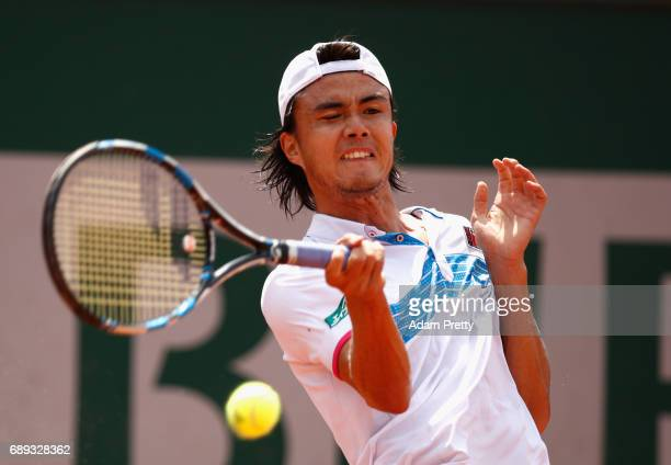 Taro Daniel of Japan plays a forehand during the mens singles first round match against Jerzy Janowicz of Polanand on day one of the 2017 French Open...