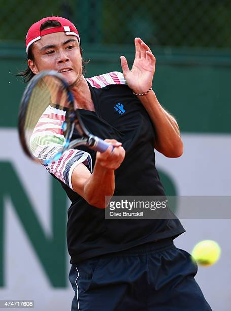 Taro Daniel of Japan plays a forehand in his Men's Singles match against Fernando Verdasco of Spain on day two of the 2015 French Open at Roland...