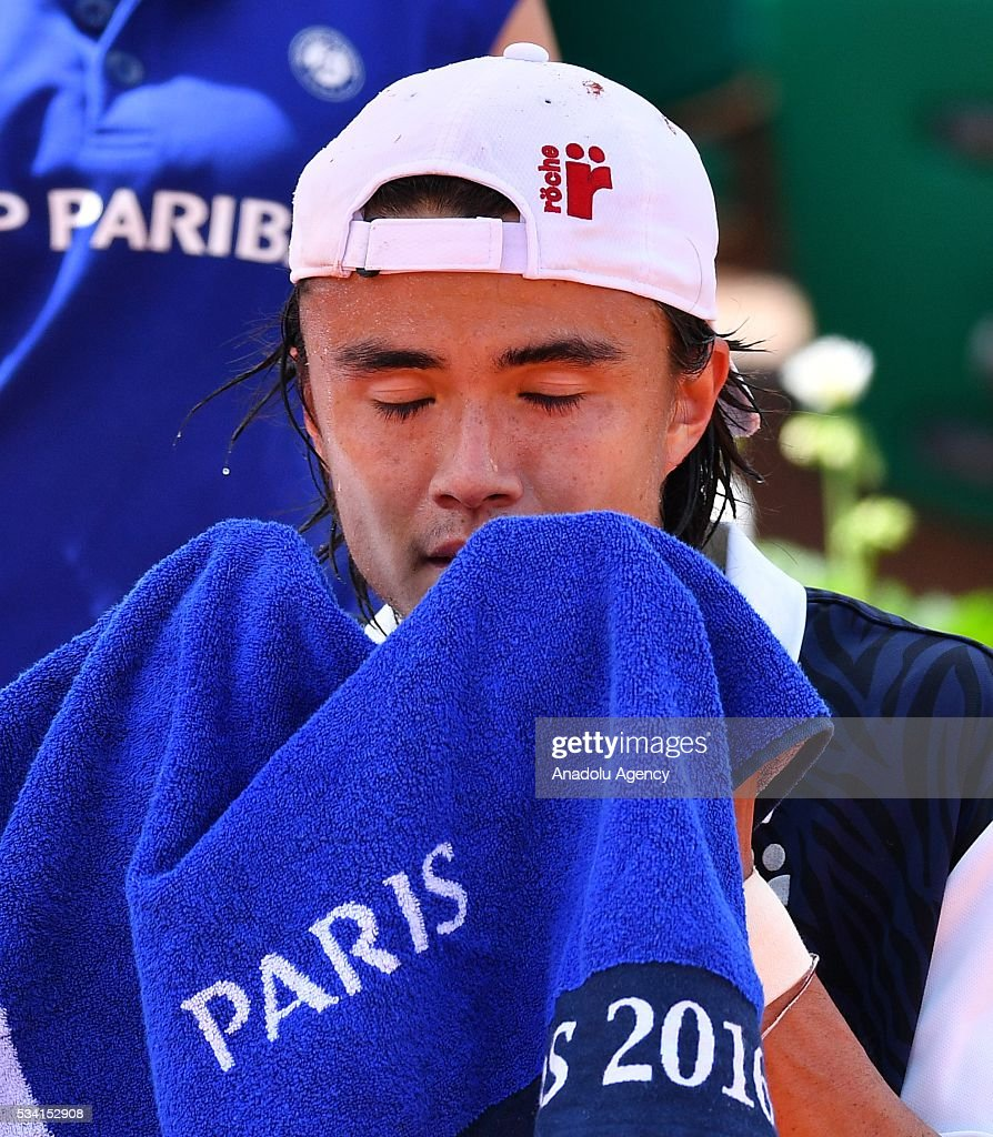 Taro Daniel of Japan reacts during the match against Stan Wawrinka (not seen) of Switzerland in their men's single 2nd round match at the French Open tennis tournament at Roland Garros in Paris, France on May 25, 2016.