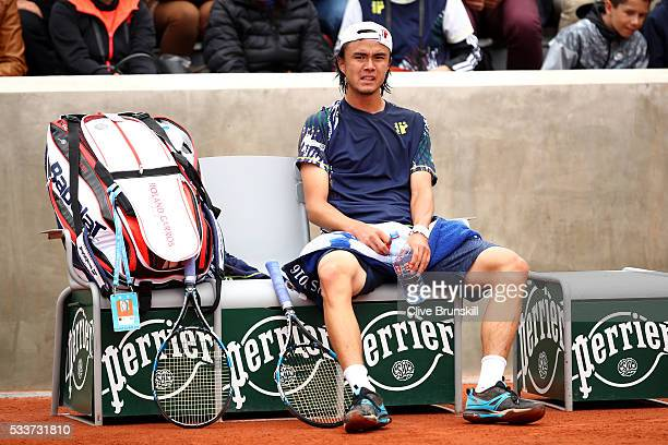 Taro Daniel of Japan reacts during the Men's Singles first round match against Martin Klizan of Slovakia on day two of the 2016 French Open at Roland...
