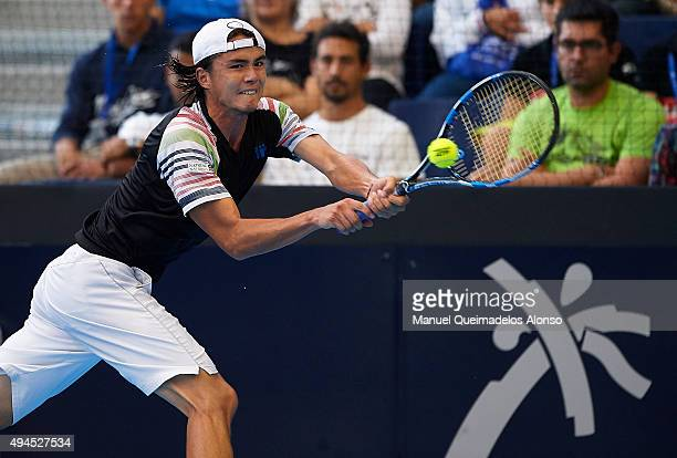 Taro Daniel of Japan returns a ball against Michal Przysiezny of Poland during day two of the ATP World Tour Valencia Open tennis tournament at the...