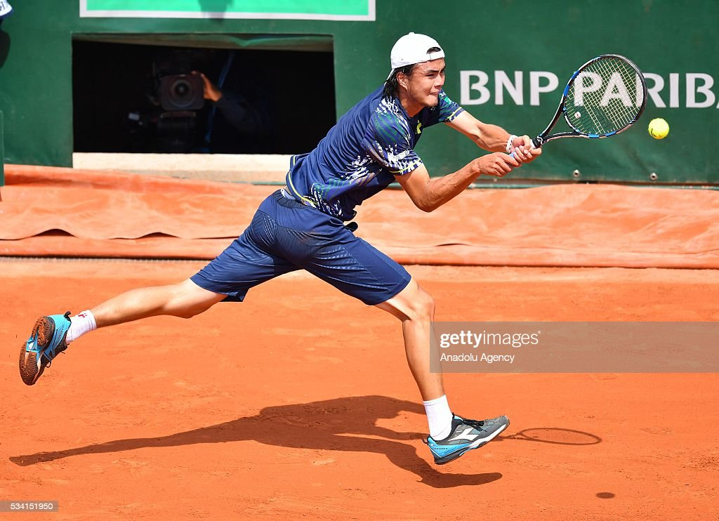 Taro Daniel of Japan returns to Stan Wawrinka (not seen) of Switzerland during their men's single 2nd round match at the French Open tennis tournament at Roland Garros in Paris, France on May 25, 2016.