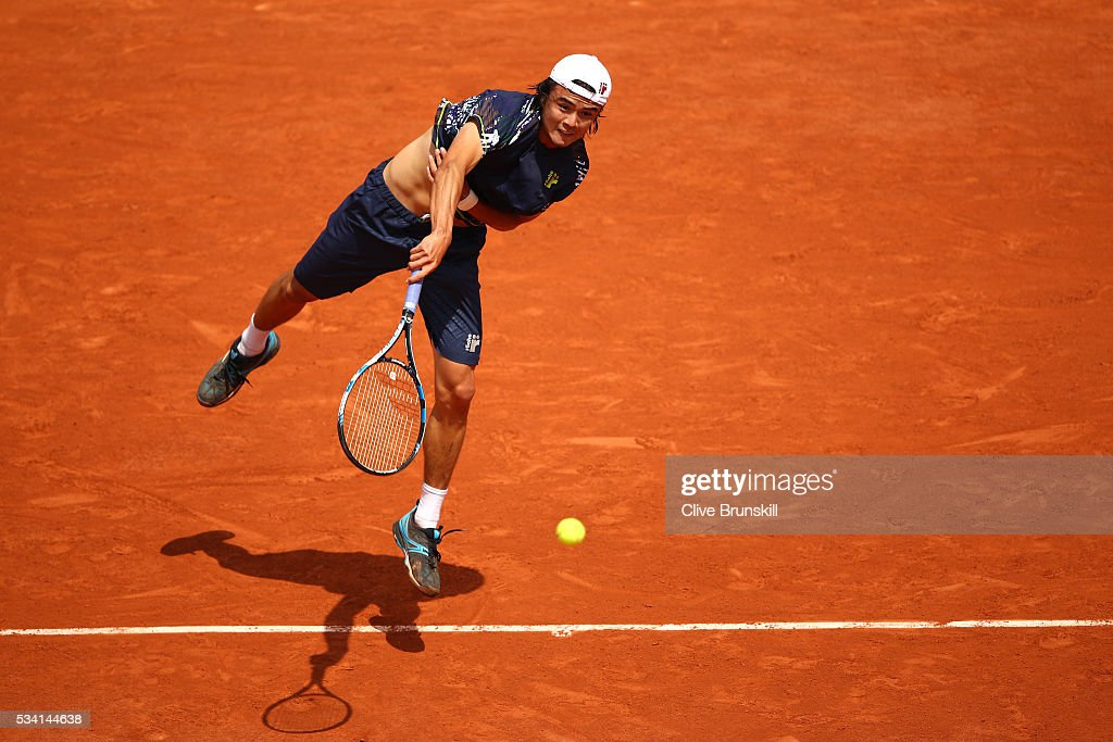 Taro Daniel of Japan serves during the Men's Singles second round match against Stan Wawrinka of Switzerland at Roland Garros on May 25, 2016 in Paris, France.