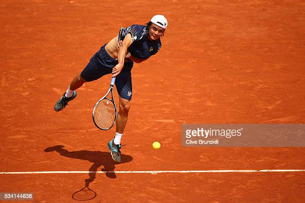 Taro Daniel of Japan serves during the Men's Singles second round match against Stan Wawrinka of Switzerland at Roland Garros on May 25 2016 in Paris...