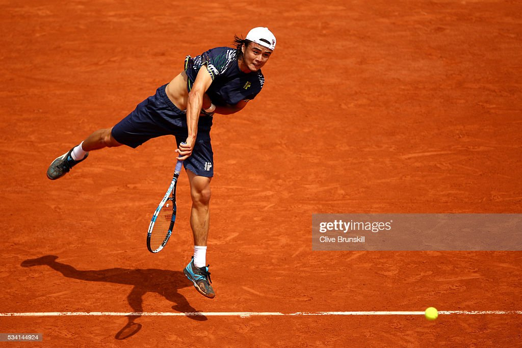 <a gi-track='captionPersonalityLinkClicked' href=/galleries/search?phrase=Taro+Daniel&family=editorial&specificpeople=7180028 ng-click='$event.stopPropagation()'>Taro Daniel</a> of Japan serves during the Men's Singles second round match against Stan Wawrinka of Switzerland at Roland Garros on May 25, 2016 in Paris, France.