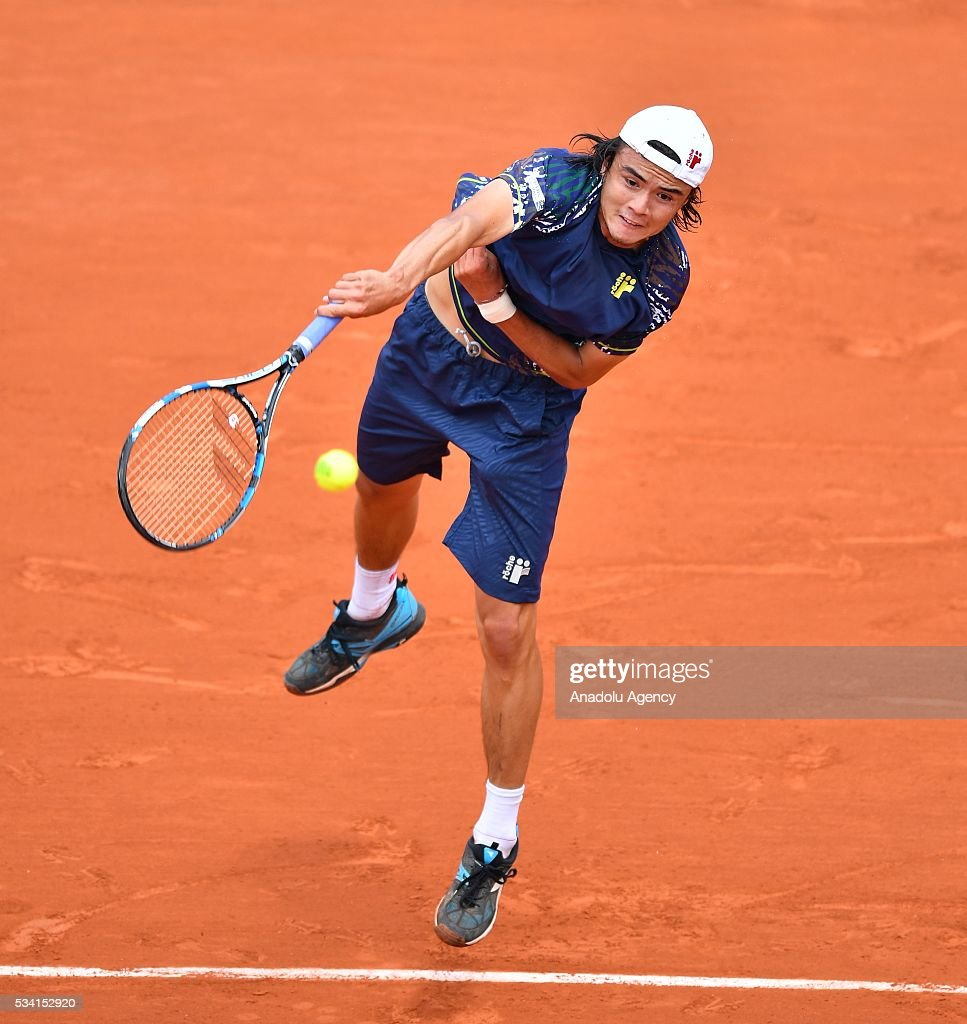 Taro Daniel of Japan serves to Stan Wawrinka (not seen) of Switzerland during their men's single 2nd round match at the French Open tennis tournament at Roland Garros in Paris, France on May 25, 2016.