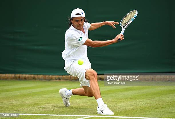 Taro Daniel of Japan stretches to play a backhand during the Men's Singles first round match against Juan Monaco of Argentina on day two of the...