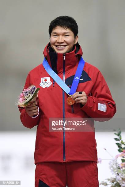 Taro Kondo of Japan poses on the podium during award ceremony for the speed skating mens 1500m on the day six of the 2017 Sapporo Asian Winter Games...