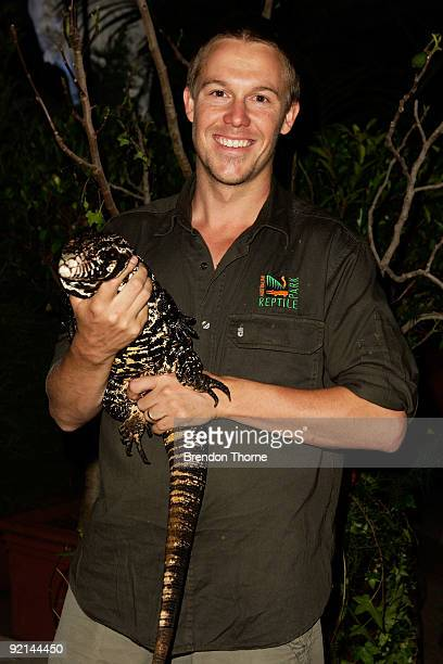 Taronga Zoo handler Tim Faulkner holds a Argentine Black and White Tegu Lizzard during the VIP Launch of the Opera Bar's 'The Best Beer Garden in the...