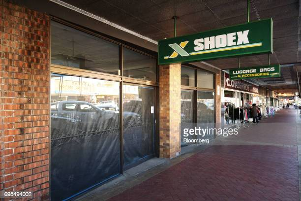 Tarp covers the windows of a vacant commercial property in Narrabri Australia on Friday May 26 2017 A decade after the shale revolution transformed...