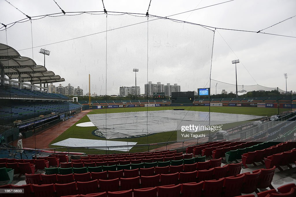 A tarp is seen on the field during the rain delay before Game 5 of the 2013 World Baseball Classic Qualifier between Team Philippines and Team New Zealand at Xinzhuang Stadium in New Taipei City, Taiwan on Saturday, November 17, 2012.