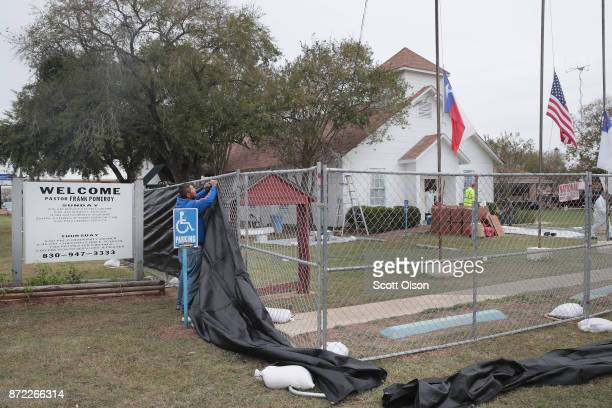 A tarp is wrapped around the First Baptist Church of Sutherland Springs as law enforcement officials wrap up their investigation into the shooting on...