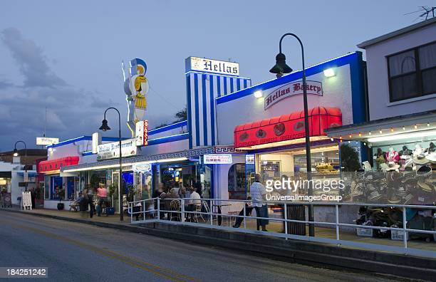 Tarpon Springs Florida main street called Dodecanese Boulevard at night with tourists and famous Hellas restaurant and bakery