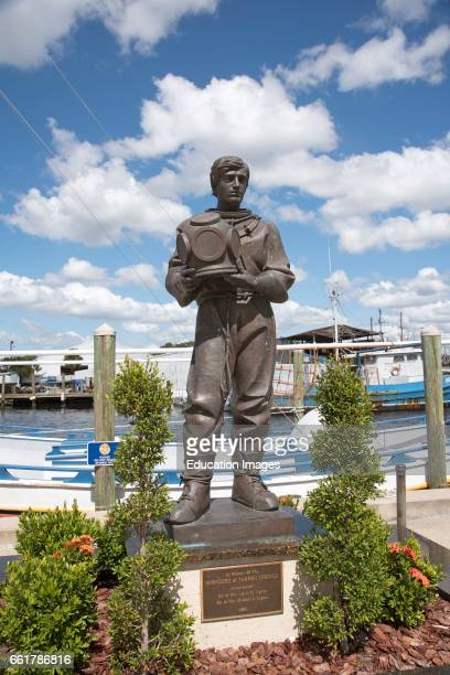 Tarpon Springs Florida USA A sculpture in memory of the 'spongers' on the waterfront at Tarpon Springs