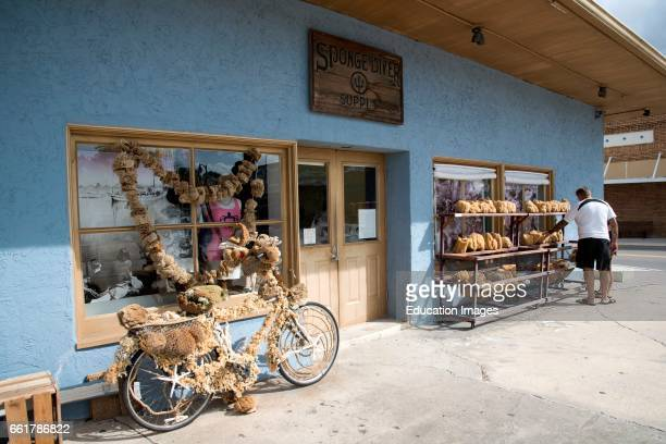 Tarpon Springs Florida USA a sponge decorated bicycle outside a sponge supply store