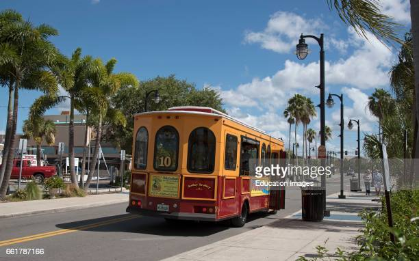 Tarpon Springs Florida USA The Jolly Trolley at a bus stop